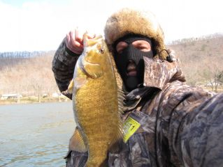 """19"""" smallie caught on hand pour, 35 degree water temp,managed to get 20 total"""